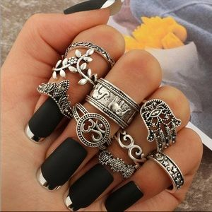 Set of 9 silver colored rings various sizes